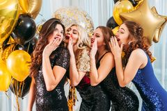 Birthday party girls flattering compliments. Special occasion. Festive celebration. Young ladies whispering flattering words, compliments to birthday girl stock photos