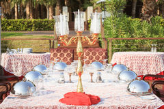 Special occasion table setting in a luxury outdoor restaurant Stock Photo