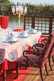 Special occasion table setting in a luxury outdoor restaurant Stock Photos