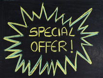 Special offer. Written special offer on the blackboard Royalty Free Stock Images