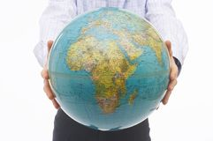 Man offering World Globe Stock Image