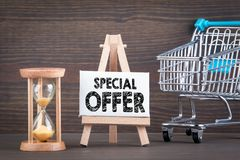 Special offer concept. Sandglass, hourglass or egg timer on wooden table. Showing the last second or last minute or time out Royalty Free Stock Images
