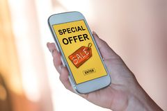 Special offer concept on a smartphone. Smartphone screen displaying a special offer concept Stock Photo