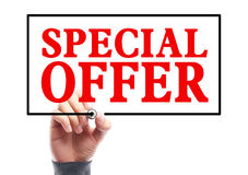 Special Offer. Hand with marker is writing the concept of Special Offer on the transparent whiteboard Stock Photo