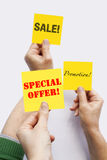 Special Offer. Hands asking for special offers and promotions Stock Image