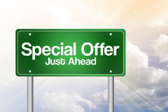 Special Offer, Just Ahead Green Road Sign Stock Photo