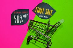 Special Offer 50% Off and Final Sale Shop Now Text and Shopping cart. Discount and promotion business concept on colorful. Background stock photo