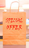 Special offer. Red text that says special offer on a bag from a clothing store Stock Images