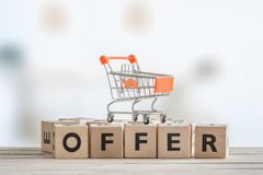 Special offer with a shopping cart Stock Images