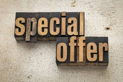 Special offer sign in wood type. Special offer sign in vintage letterpress wood type on a grunge painted barn wood background Stock Photo