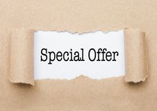 Special Offer text appearing behind brown paper. Special Offer concept text appearing behind torn brown paper envelope royalty free stock photo