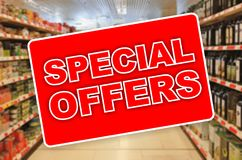 Special offers red label on an abstract Supermarket background Stock Photos