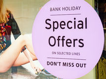 Special offers, retail incentive. An image of a special offer in a retail shop window to counteract the effects of the lingering recession Royalty Free Stock Image