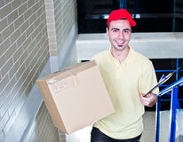 Special office delivery. Courier during delivering packages on stairs Royalty Free Stock Photos