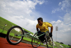SPECIAL OLYMPIC TARGET. An Indonesian disabled athlete or paralympian on ASEAN Paragames 2011 at Solo, Java, Indonesia. Indonesia is targetting 15 gold medals on Royalty Free Stock Images