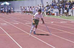 Special Olympics athlete on crutches. Competing in race, UCLA, CA Stock Photos