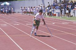 Special Olympics athlete on crutches, competing in race, UCLA, CA Royalty Free Stock Images