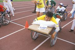 Special Olympics athlete on stretcher, competing in race, UCLA, CA Stock Photography