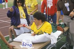 Special Olympics athlete on stretcher, competing in race, UCLA, CA Royalty Free Stock Photos