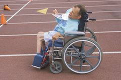Special Olympics athlete in wheelchair, approaching finish line, UCLA, CA Royalty Free Stock Photo