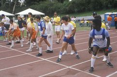 Special Olympics athletes at start line, UCLA, CA Stock Photos