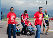 2015 Special Olympics handicapped adults in Unified Relay across Stock Photos