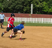 Special Olympics North America Softball Championship. Salem, VA – August 20th; A female shortstop make a play at the Special Olympics North America royalty free stock images