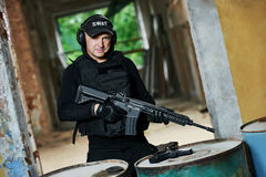 Special operations forces. Military industry. Special forces or anti-terrorist police soldier portrait,  private contractor armed with assault rifle ready to Stock Photography