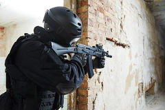 Special operations forces. Military industry. Special forces or anti-terrorist police soldier,  private military contractor armed with assault rifle ready to Royalty Free Stock Photos