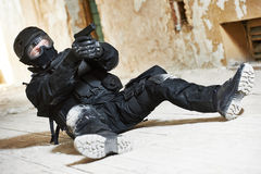 Special operations forces. Military industry. Special forces or anti-terrorist police soldier,  private military contractor armed with pistol ready to attack Royalty Free Stock Images