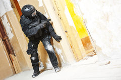 Special operations forces. Military industry. Special forces or anti-terrorist police soldier,  private military contractor armed with pistol ready to attack Stock Image