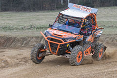 Special orange  off road car is tilted in a curve Stock Photos