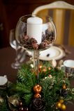 Special ornaments for Christmas days. On a table with a white candle Stock Photography