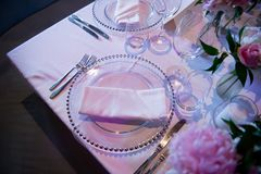 Special plate and some glasses from a wedding in a fantastic atmosphere. Formal, marriage. Special plate and some glasses from a wedding in a fantastic violet/ Royalty Free Stock Photography