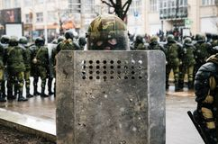 Special police unit with shields against protesters in Minsk. Minsk, Belarus - March 25, 2017 - Special police unit with shields against protesters. Belarusian royalty free stock image