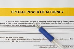 Special power of attorney concept. With pen and document Stock Photos