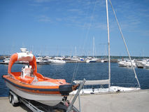 Special-purpose boat on the background of yachts Stock Photo