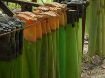 Special rain shoes. Nature park staff dry their work shos Stock Photos