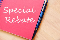 Special rebate write on notebook Stock Photo