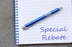 Special rebate write on notebook Stock Images