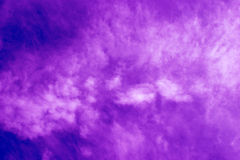 Special recycled purple paper held lit up with sunlight. For backgrounds stock images