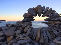 Special rock arrangement beside oceanview sunset Royalty Free Stock Image