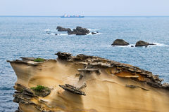 Special rocky coast with a ship Royalty Free Stock Image