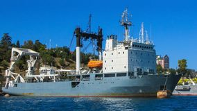 A modern rescue ship in the port. Special sea vessel for underwater cargo handling, lifting sunken ships, clearing the forester. At the stern is a load-lifting Royalty Free Stock Photo