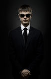 Special-service agent. Portrait  the  beautiful  man in black costume,  special-service agent or  body guard Stock Images