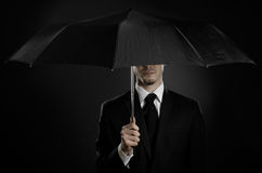 Special-service agent. Portrait  man the  beautiful  man in black costume with blak umbrella,  special-service agent or  body guard Stock Photography