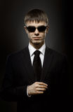 Special-service agent. Portrait  the  beautiful  man in black costume,  special-service agent or  body guard Royalty Free Stock Images