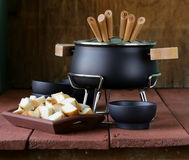 Special set of utensils for cooking fondue Royalty Free Stock Images