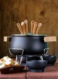 Special set of utensils for cooking fondue Stock Photography