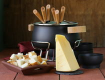 Special set of utensils for cooking fondue Royalty Free Stock Photos